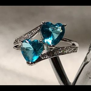 Jewelry - 925 Sterling Silver ring with light blue stones
